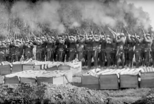 Prior to burial on May 28, 1918, U.S soldiers fire a rifle salute over the coffins of those killed the day before during a German gas and artillery attack.   U.S. Army Signal Corps movie still, courtesy of National Archives