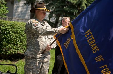 Jason Lemkau (top), a U.S. Army veteran and member of Joshua Harris Memorial VFW Post 2868, served as a member of the honor guard on May 28, during a Memorial Day Veterans ceremony at Veterans Park in Brookfield. | Alexa Rogals/Staff Photographer