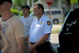 Brookfield fire chief Mark Duffek stands and listens to the service on May 28, during a Memorial Day Veterans ceremony at Veterans Park in Brookfield. | Alexa Rogals/Staff Photographer