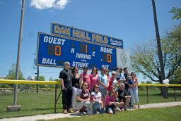 Dan Hull's family and extended family in front of the new scoreboard sign June 3, during a dedication ceremony at the Elhert Park softball field in Brookfield. | Alexa Rogals/Staff Photographer