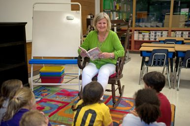 Retiring teacher Judy Sayre reads to her students in class on June 7, during the last day of class at Blythe Park Elementary School in Riverside.   Alexa Rogals/Staff Photographer