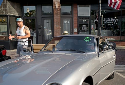 Participants park their car in a spot for guests to view on June 7, during the first monthly Cruise Night of the summer in downtown Riverside. | Alexa Rogals/Staff Photographer