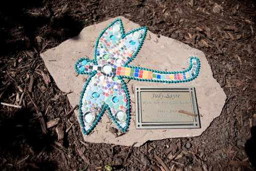 A dedicated plaque for retiring teacher Judy Sayre is placed next to the sculpture on May 17 during a sculpture unveiling and surprise butterfly release at Blythe Park School in Riverside.   Alexa Rogals/Staff Photographer