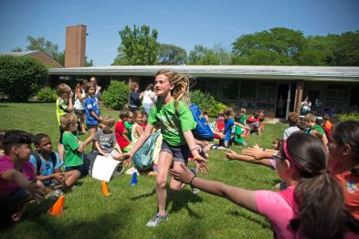 "Outgoing fifth graders run down a line of underclassmen for a ""clap out"" on June 7, during the last day of school at Blythe Park Elementary School in Riverside. 