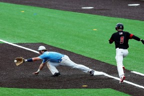 Nazareth's Zach Carmignani stretches to make a great catch at first base at the Class 3A state tournament. (Courtesy Nazareth Academy)