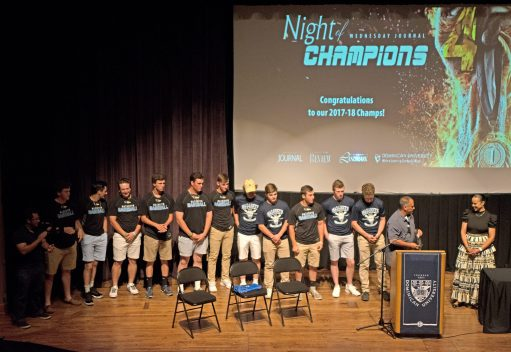 The Nazareth Academy varsity baseball team accepts their award on Wednesday, June 20, during the 4th annual Night Of Champions in the Lund Auditorium at Dominican University in River Forest. | Alexa Rogals/Staff Photographer
