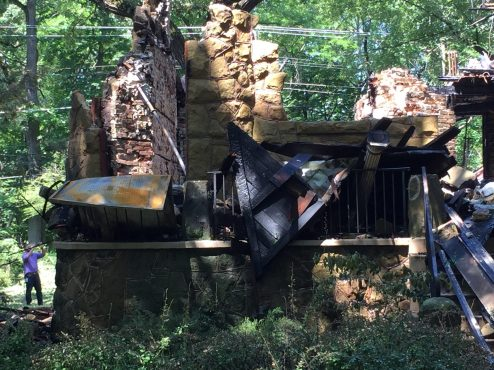 Later on the morning of June 28, fire investigators remained on the scene, documenting the smoking ruins and trying to determine a cause. (Bob Uphues | Staff)