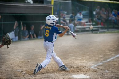 Brookfield's Joey Garvey makes solid contact during a game at the Illinois District 9 Little League Baseball Tournament. (Alexa Rogals/Staff Photographer)