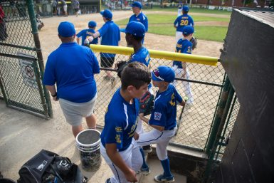 The Brookfield Nationals get ready to take the field between innings at the Illinois District 9 Little League Baseball Tournament at Kiwanis Park. (Alexa Rogals/Staff Photographer)