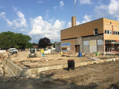 Crews excavate the site to make way for the footings that will support the walls of a new gymnasium at Brook Park School in LaGrange Park on Aug. 9. (Bob Uphues   Staff)