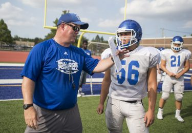RBHS head coach Brendan Curtin provides instruction to one of his players during practice. (Alexa Rogals/Staff Photographer)