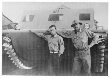 Bud Carlsen (right) and an unknown Marine stand in front of an LVT1 (landing vehicle, tracked), or amtrac. It was on an amtrac like this that Carlsen assaulted Red Beach on Betio Island on Nov. 20, 1943.