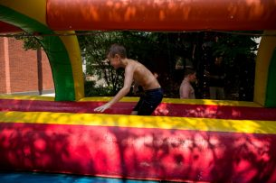 Joe Duffy plays on the slip-n-slide on Aug. 18, during the Maplewood Road 30th annual block party in Riverside. | Alexa Rogals/Staff Photographer