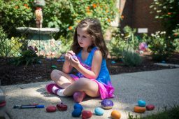 Ruby Walsh colors rocks to go in the school's front garden on Aug. 23, during a teddy bear picnic after the first day of kindergarten at Hollywood Elementary School in Brookfield. | Alexa Rogals/Staff Photographer