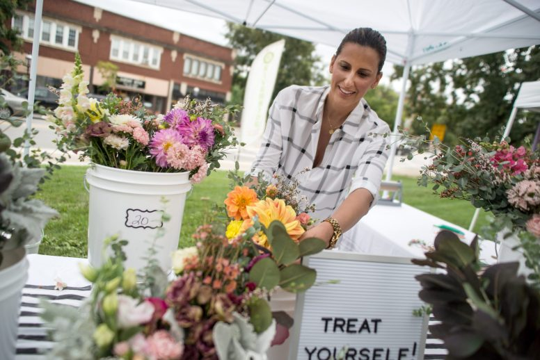 Riverside resident Nina Joseph Makovski, owner of Sweet Stems, sells fresh handmade bouquets at the Riverside Farmers Market on Aug. 29 in Centennial Park in downtown Riverside. The market operates there every Wednesday through Oct. 10 from 2:30 to 7 p.m. | Alexa Rogals/Staff Photographer