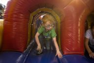Jack Flynn, 4, of North Riverside, plays in a bounce house on Sept. 14, during the annual Autumn Fest and Chili Cook-off at the North Riverside Village Commons. | Alexa Rogals/Staff Photographer