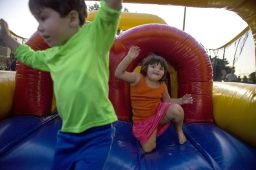 Children play in the bounce houses on Sept. 14, during the annual Autumn Fest and Chili Cook-off at the North Riverside Village Commons. | Alexa Rogals/Staff Photographer