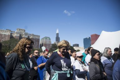 Participants get ready to start the walk along Lake Shore Drive on Sept. 22, during the American Foundation for Suicide Prevention Out of the Darkness Walk at Grant Park in Chicago. | Alexa Rogals/Staff Photographer