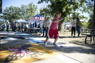 A child runs through the festival area where articles made sidewalk chalk art on Sept. 22, during the annual Fine Arts Festival at Kiwanis Park in Brookfield. | Alexa Rogals/Staff Photographer