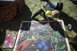 Kids add their own colors to the Compassion Factory's kids area on Sept. 22, during the annual Fine Arts Festival at Kiwanis Park in Brookfield. | Alexa Rogals/Staff Photographer