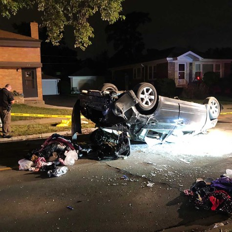 The getaway car, a 2008 Nissan Altima, rolled over onto its top after the crash, trapping the driver and another passenger inside. Police pulled the two from the vehicle and extinguished a fire that started after the impact. (Photo courtesy of the Riverside Police Department)