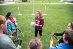 Jenna Tucker, from Loyola University, teaches the kids the basic rules of the game on Sept. 29, during Quidditch outside of the North Riverside Village Commons on Des Plaines Avenue. | Alexa Rogals/Staff Photographer