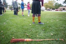 Participants hold up their brooms as they prepare to run around on Sept. 29, during Quidditch outside of the North Riverside Village Commons on Des Plaines Avenue. | Alexa Rogals/Staff Photographer