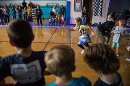 Students race down the gym floor as groups cheer them on Oct. 5, during the walkathon inside the gymnasium at Congress Park School in Brookfield. | Alexa Rogals/Staff Photographer