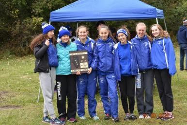 The Riverside-Brookfield High School girls cross country team won its own regional with a score of 24. (Photo by John Keen)