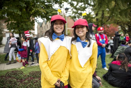 Twin sisters Mia Alcaraz and Lilly Alcaraz, 10, of Brookfield, wear matching halloween costumes during the annual Monsters on Mainstreet trick-or-treating event on Oct. 27.   ALEXA ROGALS/Staff Photographer