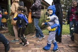 Children dressed up for the costume contest wait in line to get their free taffy apples and pumpkins during the annual Monsters on Mainstreet trick-or-treating event on Oct. 27.   ALEXA ROGALS/Staff Photographer
