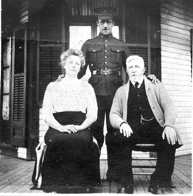 Barss poses with his parents, Libby and John, during a going-away party thrown for him in Montreal just before he shipped off to France and to the Western Front, where he was badly wounded. | Photo courtesy of Joe Barss