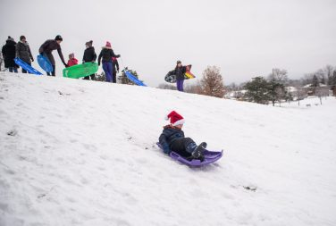 Matthew Wolfe, 5, of Riverside, goes sledding on Nov. 26, at the North Riverside Village Commons sledding hill on Des Plaines Avenue in North Riverside. | Alexa Rogals/Staff Photographer