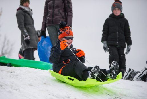 Edward Wolfe, 7, of Riverside, rides a sled down the hill on Nov. 26, at the North Riverside Village Commons sledding hill on Des Plaines Avenue in North Riverside. | Alexa Rogals/Staff Photographer