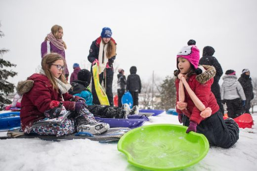 A group hangs out on the top of the hill on Nov. 26, at the North Riverside Village Commons sledding hill on Des Plaines Avenue in North Riverside. | Alexa Rogals/Staff Photographer