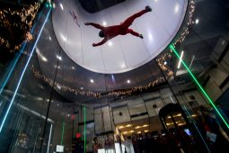 The iFly instructor glides and does tricks through the air as Riverside-Brookfield High School students glance in amazement. | Sebastian Hidalgo/Contributor