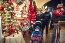 Families peruse the holiday decorations and items for sale at Shamrock Garden Florist on East Burlington Street. | Alexa Rogals/Staff Photographer