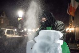 Dave Litke of Johnson Studios Ice Sculptures, carves a block of ice outside Mollie's Public House on Forest Avenue. | Alexa Rogals/Staff Photographer
