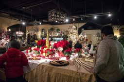 Complimentary food and drinks are left out for attendees at Shamrock Garden Florist Ltd. on Dec. 7, during the 44th annual Chamber of Commerce Holiday Stroll in downtown Riverside. | Alexa Rogals/Staff Photographer