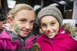 Mia Marchetti, left, and Giada Decola, both 9 and from Riverside, stand for a photo and show off their painted faces on Dec. 7, during the 44th annual Chamber of Commerce Holiday Stroll in downtown Riverside. | Alexa Rogals/Staff Photographer