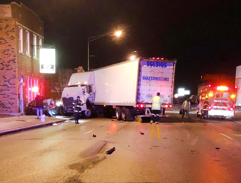 After being struck head-on by a Chevy Equinox, this westbound semi-tractor trailer jackknifed and T-boned an eastbound Kia sedan, pushing it off the road and into a building. (Photo courtesy of the Brookfield Police Department)