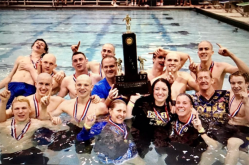 LTHS swimming coach Scott Walker (middle, second from right) retired in 2018 after 24 years coaching the Lions' boys swimming, girls swimming and water polo teams. He coachad the boys swimming team to a pair of state titles. (File photo)