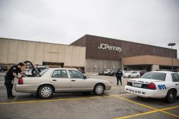 Police officers from different towns go to their vehicles parked outside of JCPenny on Jan. 2, at the North Riverside Park Mall. | Alexa Rogals/Staff Photographer