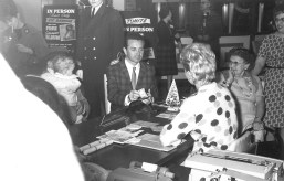 Singer Vic Damone peels off a 00 bill to open an honorary account at Marshall Savings to the delight of a fan sitting next to him during his appearance at the association's 100 Million Dollar-versary in January 1963. | Photo courtesy Liz Faron collection
