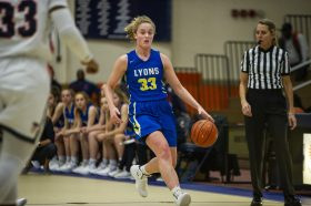 LTHS junior Lily Courierhad a double of 25 points and 10 rebounds in the Lions' 52-47 win over Downers Grove South in a West Suburban Conference crossover. (Alex Rogals/Staff Photographer)