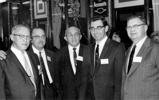 Marshall Savings and Loan officers Jerome Moravec (above, center) and Henry Moravec Jr. (second from right), both vice presidents, bask in the glow of the 100 Million Dollar-versary celebration in January 1963. | Photo courtesy Liz Faron collection