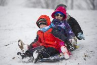 Shawn Marvin, 4; Galaxy Delago, 7; and Becca Marvin, all of Lyons, sled down the hill at Swan Pond Park in Riverside on Jan. 12 during a snowfall that blanketed the area with a few inches of snow, snapping an unseasonably mild stretch of weather the week before. | Alexa Rogals/Staff Photographer