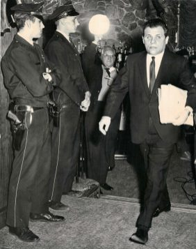 Manny Skar, under the watch of hired armed guards, walks into the cocktail bar of the Sahara Inn North on Dec. 16, 1964 for a news conference he called to deny that the Sahara was mob-connected under his management and to complain about the hotel's new management. | Courtesy Liz Faron collection