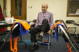 """Hank Ohan, of North Riverside, does leg lifts between games on Feb. 20, 2019, during """"Bingocize"""" at the North Riverside Public Library.   ALEXA ROGALS/Staff Photographer"""