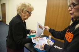 """Cathy McMahon, of Oak Park, collects a prize after winning the first round of """"Bingo"""" on Feb. 20, during Bingocize at the North Riverside Public Library.   ALEXA ROGALS/Staff Photographer"""